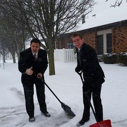 Kayden Carlos and Kekoa Kane shovel snow while serving in the Maryland Baltimore Mission in December 2014.