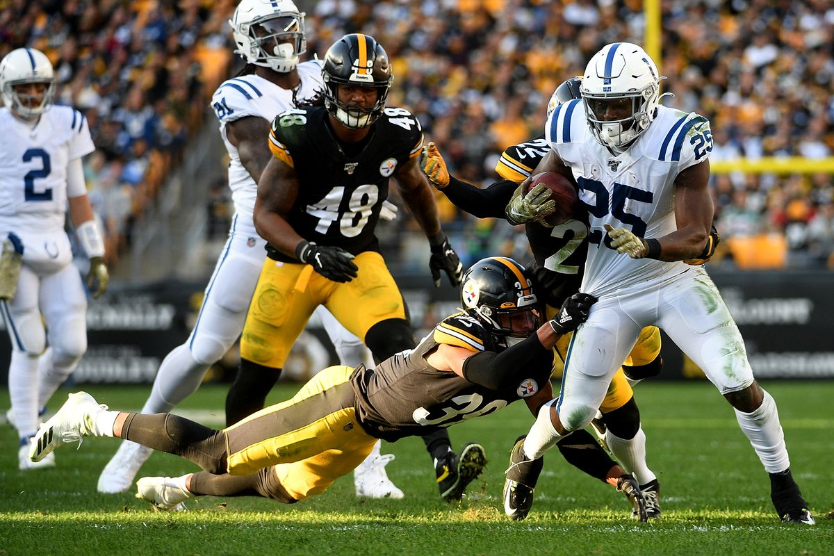 Marlon Mack of the Indianapolis Colts carries the ball against Minkah Fitzpatrick of the Pittsburgh Steelers in the second half during the game at Heinz Field on November 3, 2019 in Pittsburgh, Pennsylvania.