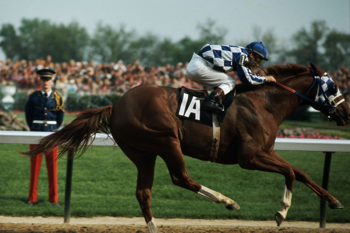 Ron Turcotte, a Triple Crown winner, rides Secretariat towards the finish line and wins the 1973 Kentucky Derby at Churchill Downs.