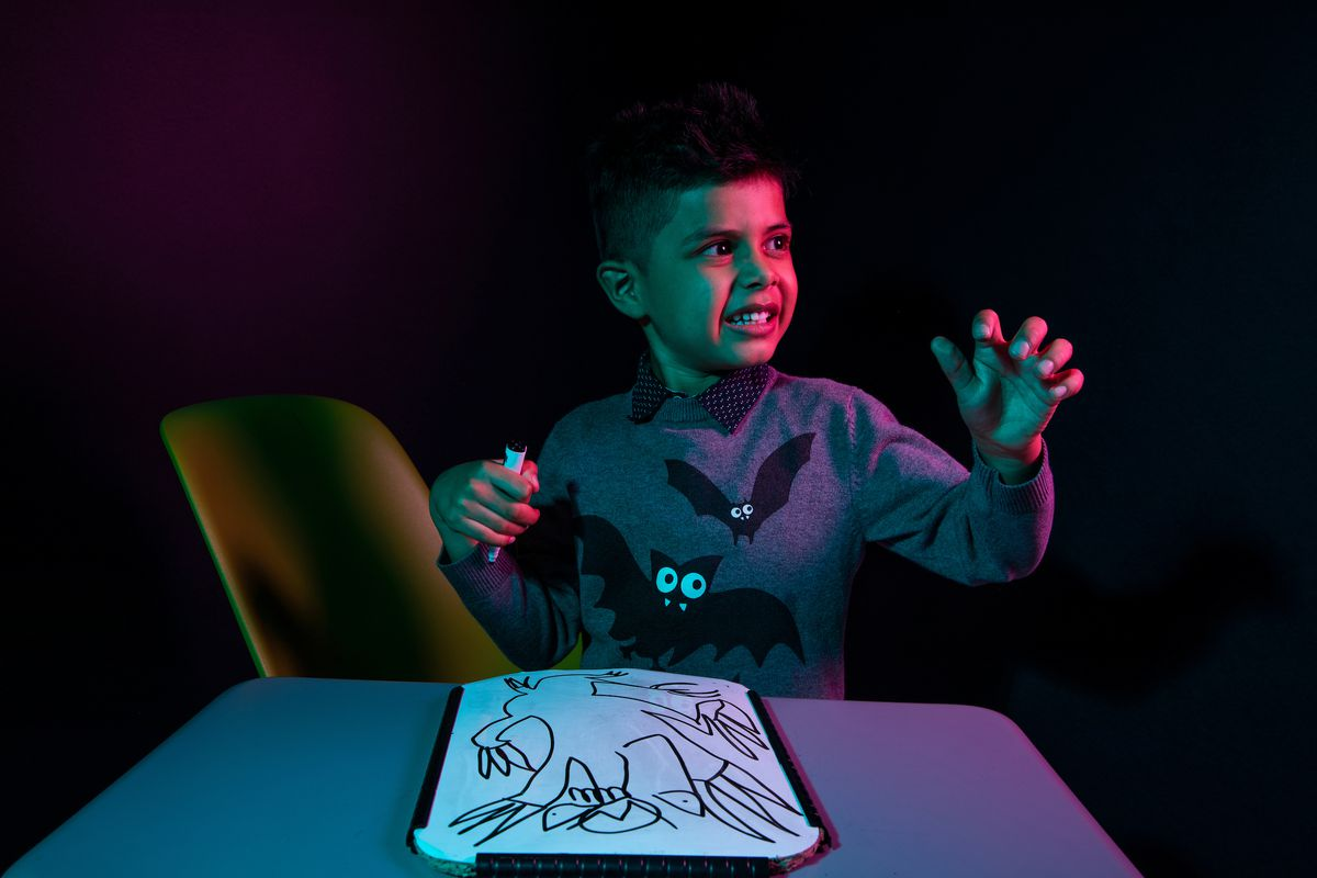 Benjamin has his photo taken at Utah Valley University in Orem on Friday Oct. 30, 2020. Benjamin is a participant in the Super Spectrum Showcase and Soiree at the Melisa Nellesen Center for Autism at UVU.