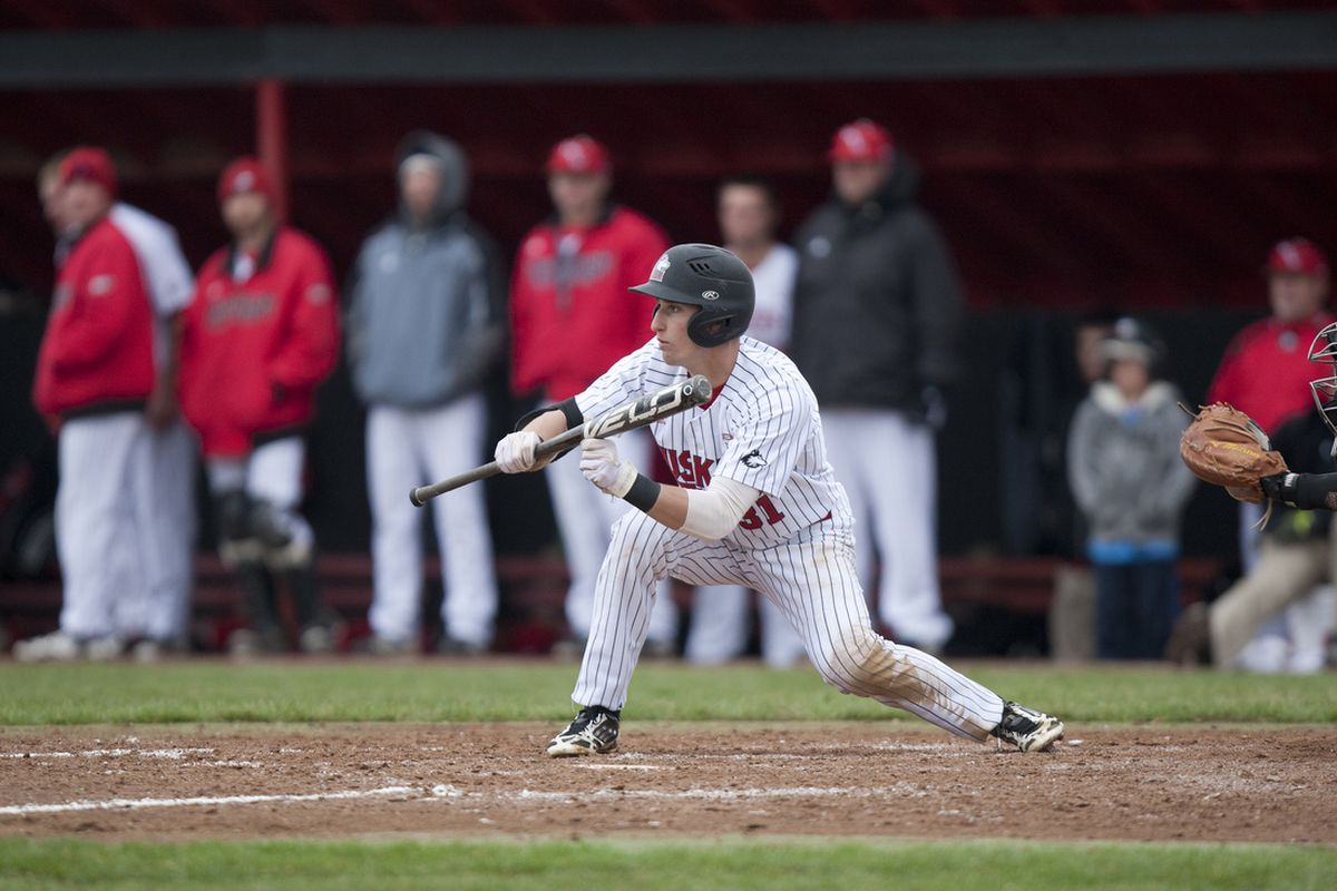 Tommy Hook squares to bunt.