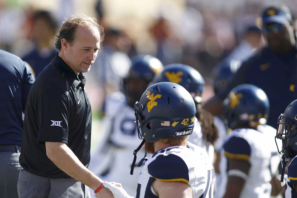Who know Dana Holgorsen was a giant?! Or wait, are the Mountaineers small people?