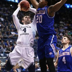 Brigham Young Cougars guard Nick Emery (4) puts up a wild shot with Texas Arlington Mavericks forward Julian Harris (20) defending as BYU and the University of Texas at Arlington play in NIT basketball action at the Marriott Center in Provo, Utah on Wednesday, March 15, 2017.