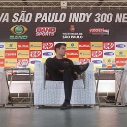 Brazil's Helio Castroneves, right, speaks at a joint news conference with fellow IndyCar drivers Dario Franchitti, of Scotland, left, and Will Power, of Australia, center, in Sao Paulo, Brazil, Friday, April 27, 2012. Brazil will host the 4th race of the IndyCar season on April 29.