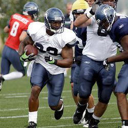 Seattle Seahawks running back Julius Jones runs with the ball during NFL football practice drills Tuesday.