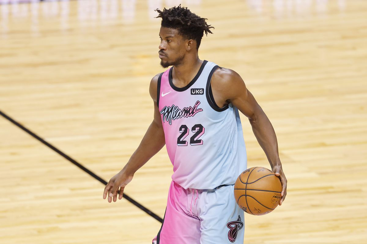Jimmy Butler of the Miami Heat dribbles the ball up the court against the Boston Celtics during the second quarter at American Airlines Arena on January 06, 2021 in Miami, Florida.