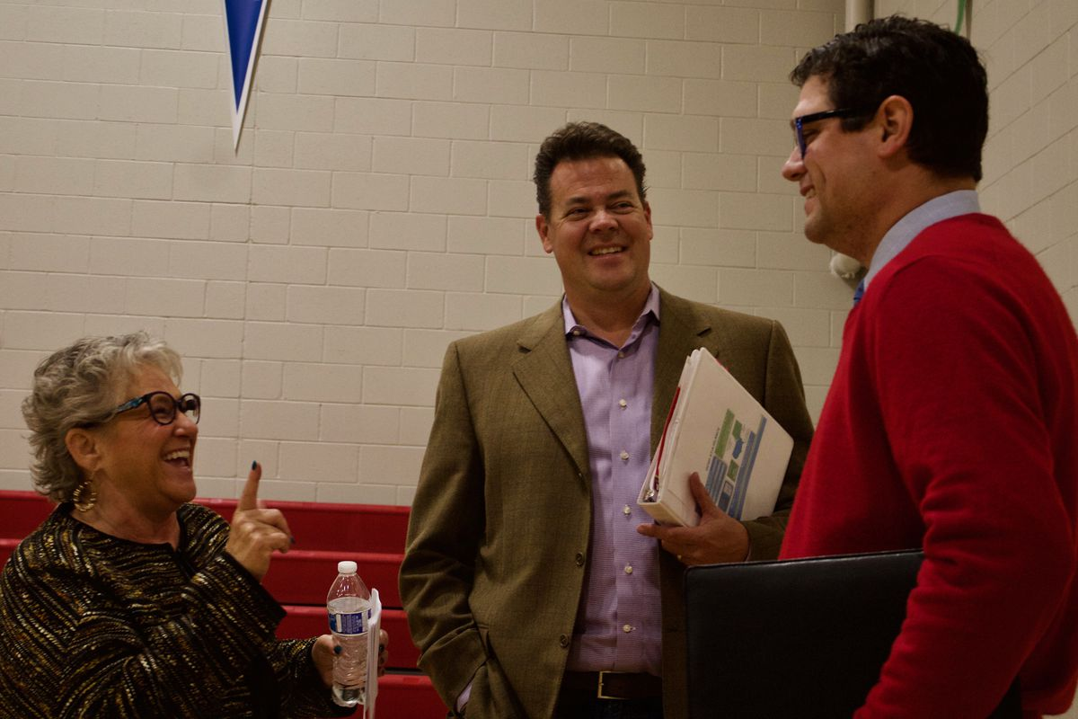 """Douglas County school board candidates Chris Schor, left, Grant Nelson and Ryan Abresch chat before a candidate forum. Schor is a member of the """"CommUnity Matters"""" slate, while Nelson and Abresch are members of the """"Elevate Douglas County"""" slate. (Photo by Nic Garcia)"""