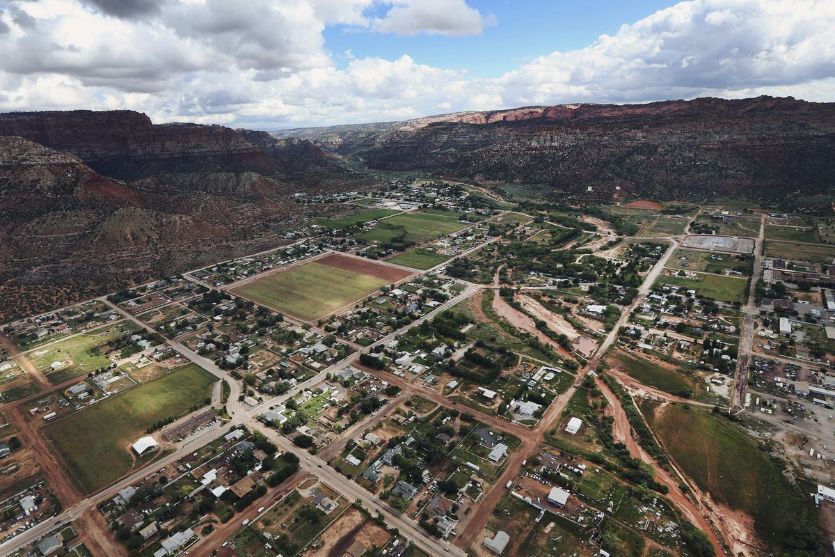 FILE - This Sept. 16, 2015, file photo, shows an aerial photo of Hildale, Utah, next to its sister city of Colorado City, Ariz. A polygamous group based on the Utah-Arizona border is letting go of the sprawling building where its members worshipped, in th