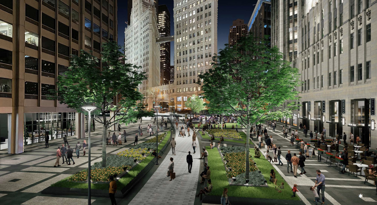 An overhead view of a landscaped pedestrian plaza surrounded by taller buildings. There is a gently curving pathway lined with trees and planters.