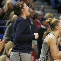 UConn's Katie Lou Samuelson (33) celebrates along with Kyla Irwin (25) during the Notre Dame Fighting Irish vs UConn Huskies women's college basketball game in the Women's Jimmy V Classic at the XL Center in Hartford, CT on December 3, 2017.
