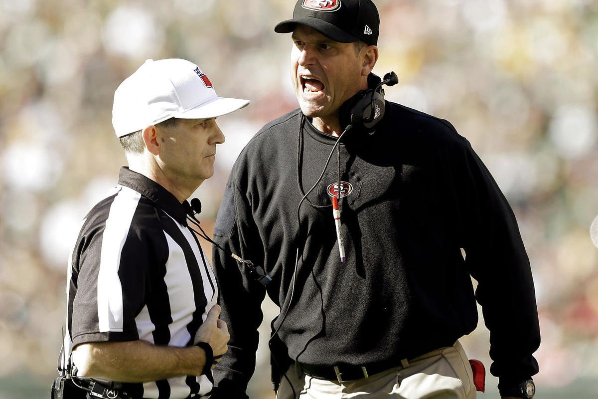 San Francisco 49ers head coach Jim Harbaugh argues a call with referee David White.
