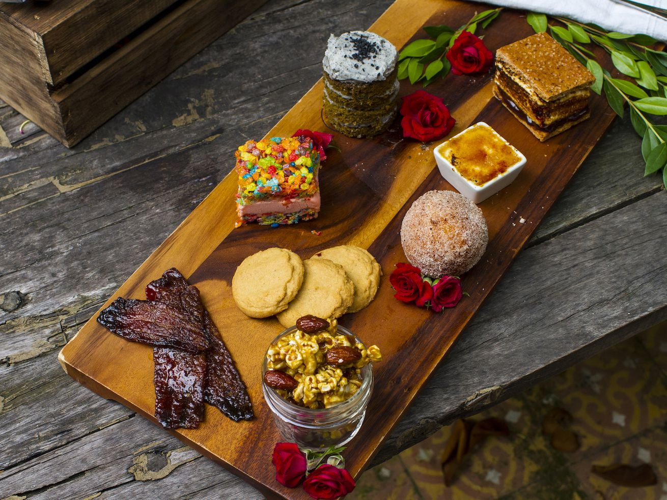 Lowell Farms Cannabis Cafe's sweet flight with candied bacon, caramel popcorn with Thai chili almonds, peanut butter cookies, sweet potato beignets, crème brûlée, homemade s'mores, and an ice cream sandwich