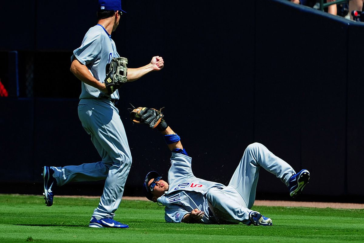 Darwin Barney of the Chicago Cubs makes a diving catch for an out against Dan Uggla of the Atlanta Braves at Turner Field in Atlanta, Georgia. (Photo by Scott Cunningham/Getty Images)