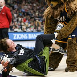 The Jazz Bear pulls NBA photographer Melissa Majchrzak off the sideline during the game against the Cleveland Cavaliers at Vivint Smart Home Arena in Salt Lake City on Saturday, Dec. 30, 2017.