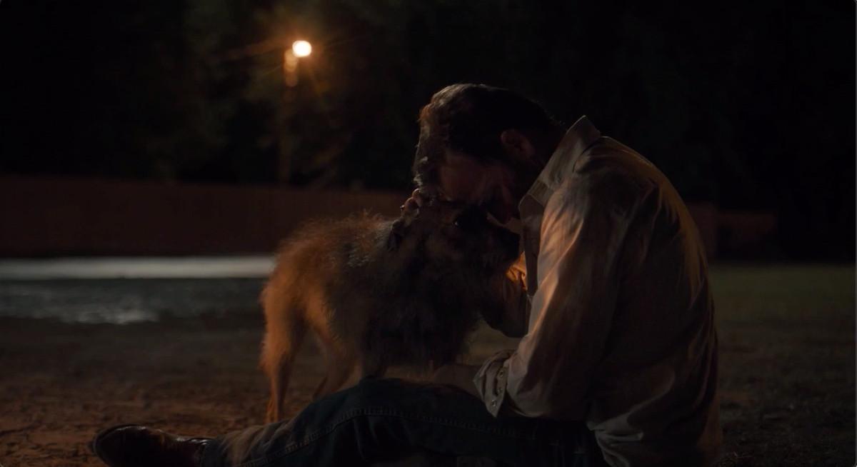 Roland cuddling a stray dog