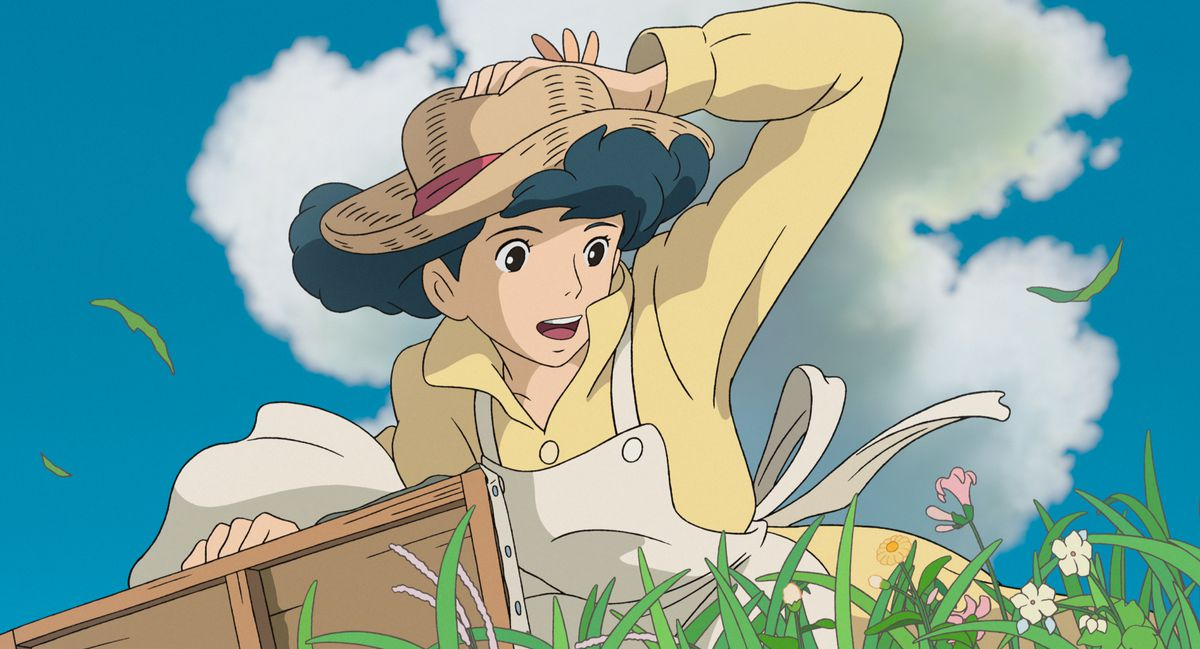 Affiliate Marketing A woman in a green, flowery field clutches her hat against the wind in The Wind Rises