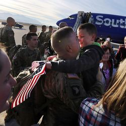 Sgt. Jim Booher hugs his son, Cole, as soldiers from Detachment 2, 101st Airborne Division (Air Assault) return to Utah on Friday, Nov. 18, 2016, following an 11-month deployment to Iraq.