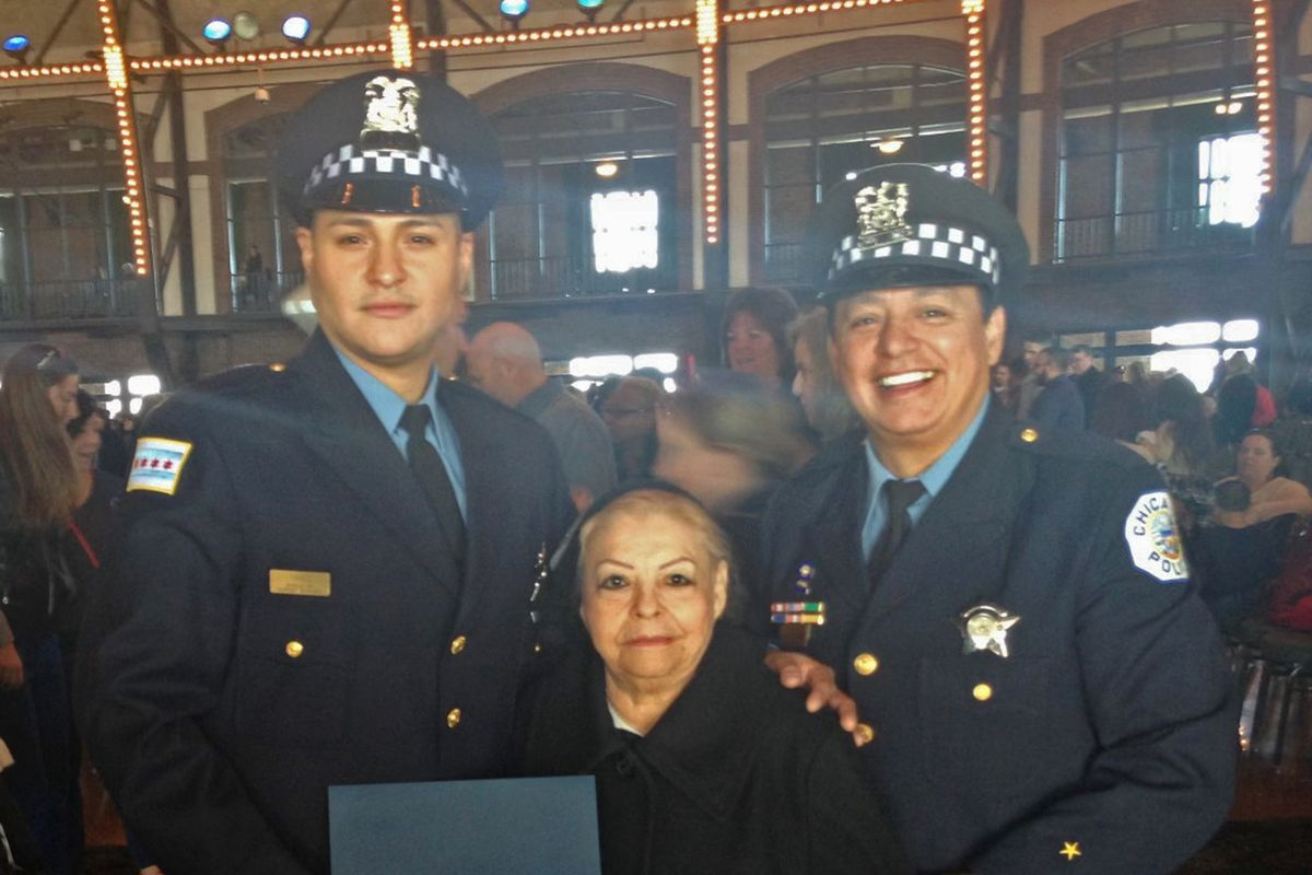 Carlos Yanez Jr. (left) with his parents at his swearing-in ceremony on Navy Pier.