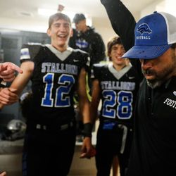 Stansbury coach and players celebrate after winning a high school football game against Tooele at Stansbury High School in Stansbury Park on Friday, Sept. 17, 2021.