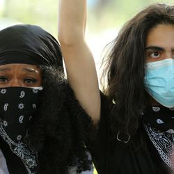 Jemilla Knowles becomes emotional as she and Jacob Berkowitz join a large group of demonstrators gathered at Washington Square Park in Salt Lake City on Monday, June 1, 2020. They marched to the Salt Lake City Public Safety Building chanting for justice.