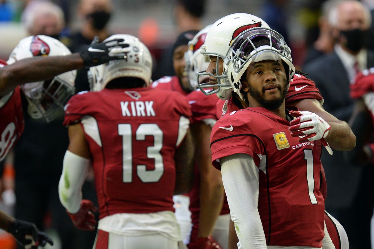 Arizona Cardinals quarterback Kyler Murray  celebrates his touchdown by Arizona Cardinals wide receiver Christian Kirk with Arizona Cardinals wide receiver Larry Fitzgerald (against the Miami Dolphins during the first half at State Farm Stadium.