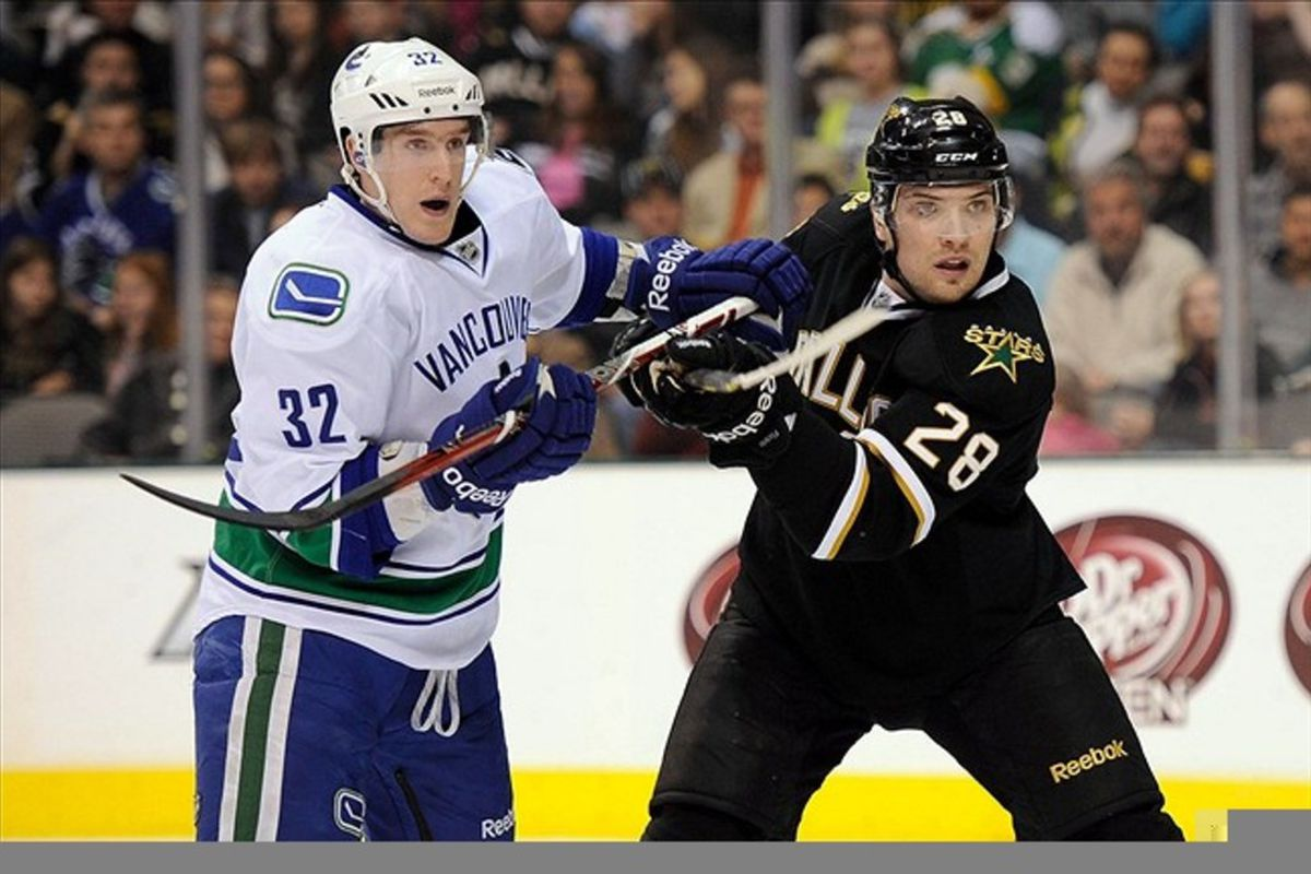Feb 26, 2012; Dallas, TX, USA; Vancouver Canucks right wing Dale Weise (32) and Dallas Stars defenseman Mark Fistric (28) fight in front of the goal during the first period at the American Airlines Center. Mandatory Credit: Jerome Miron-US PRESSWIRE