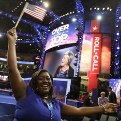 Ohio delegate Julia Hightower celebrates as President Barack Obama is nominated for the Office of the President of the United States at the Democratic National Convention in Charlotte, N.C., on Thursday, Sept. 6, 2012. (AP Photo/David Goldman)