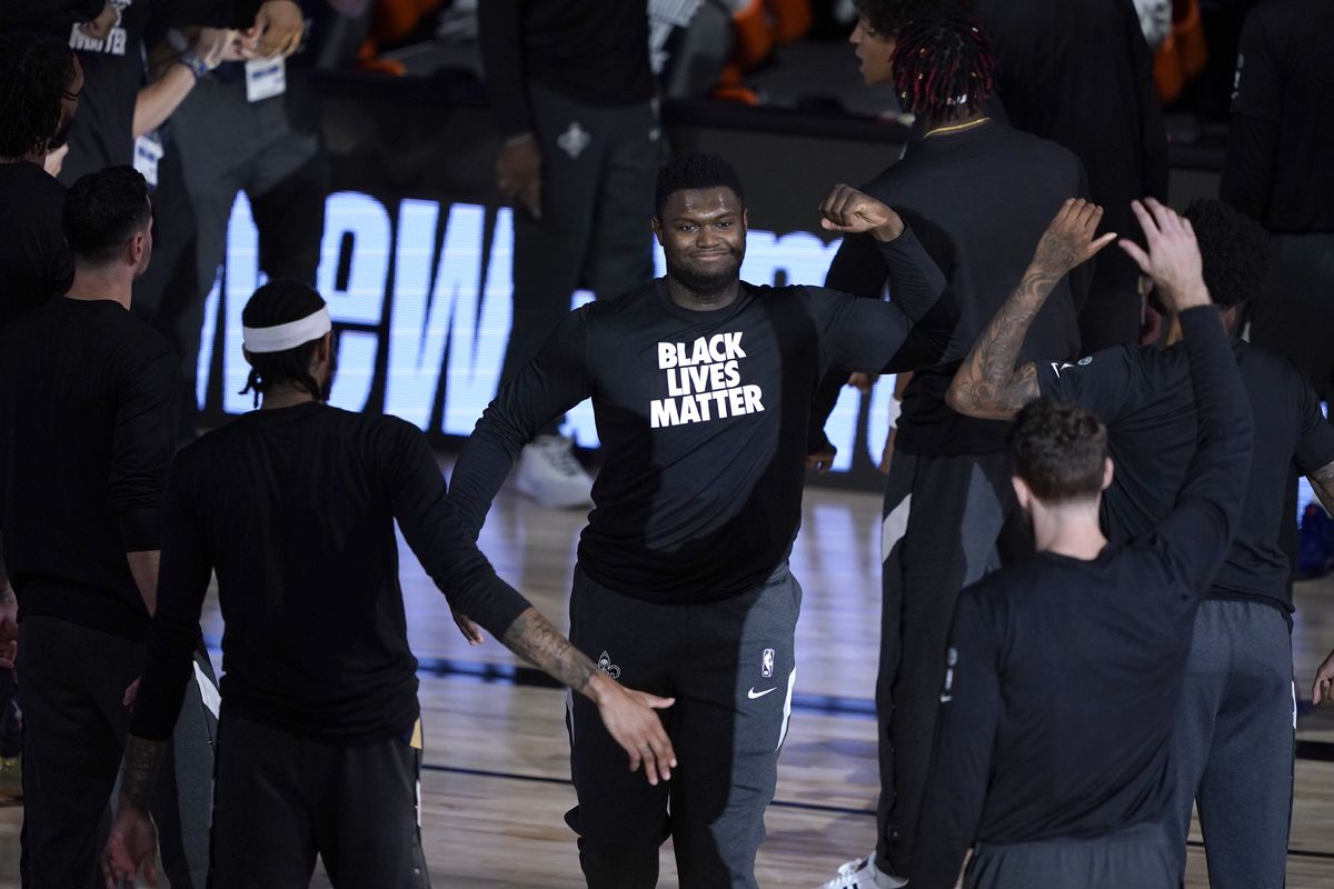 Zion Williamson of the New Orleans Pelicans wears a Black Lives Matter shirt as he is introduced before the start of an NBA basketball game against the Utah Jazz at HP Field House at ESPN Wide World Of Sports Complex on July 30, 2020 in Reunion, Florida.