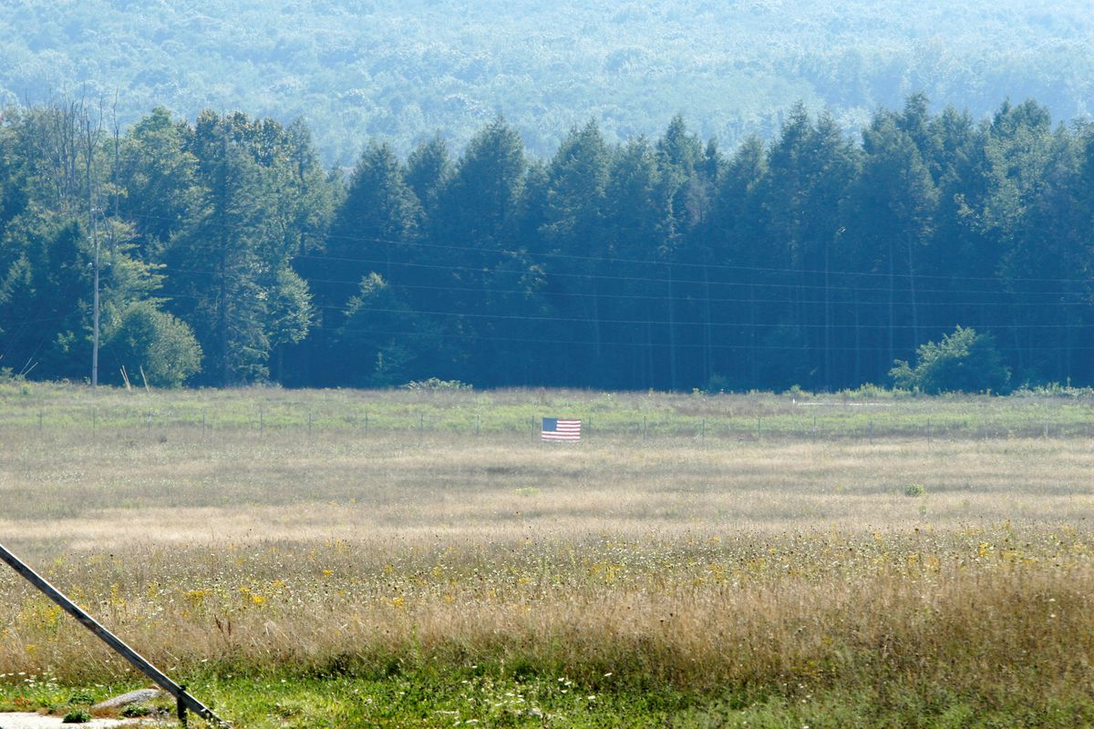 An American flag marks where Flight 93 crashed on 9/11.