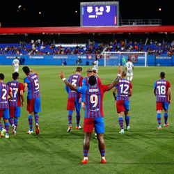 The players celebrate the opener