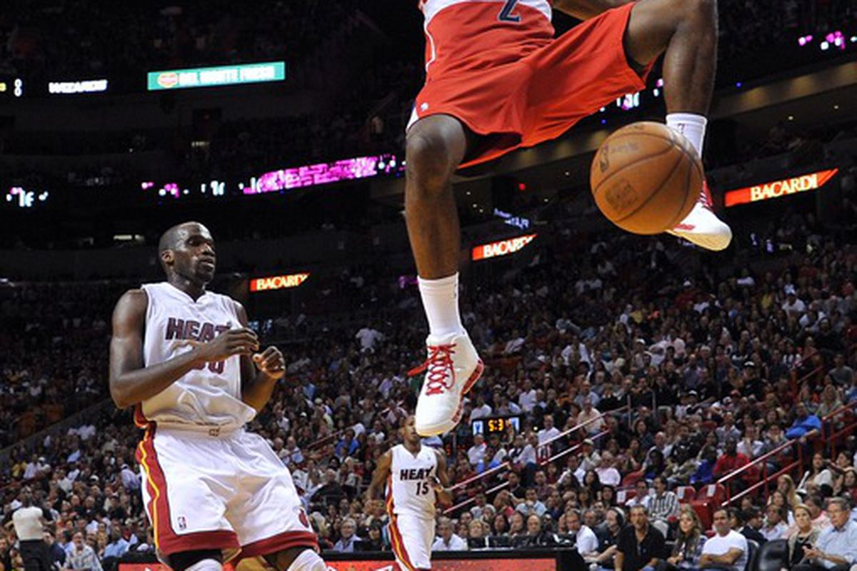 April 21, 2012; Miami, FL, USA; Washington Wizards point guard John Wall (2) dunks past Miami Heat center Joel Anthony (50) during the first half at American Airlines Arena. Mandatory Credit: Steve Mitchell-US PRESSWIRE