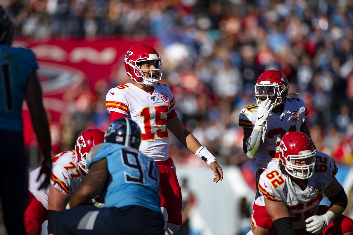 Patrick Mahomes of the Kansas City Chiefs communicates with teammates during the third quarter against the Tennessee Titans at Nissan Stadium on November 10, 2019 in Nashville, Tennessee.