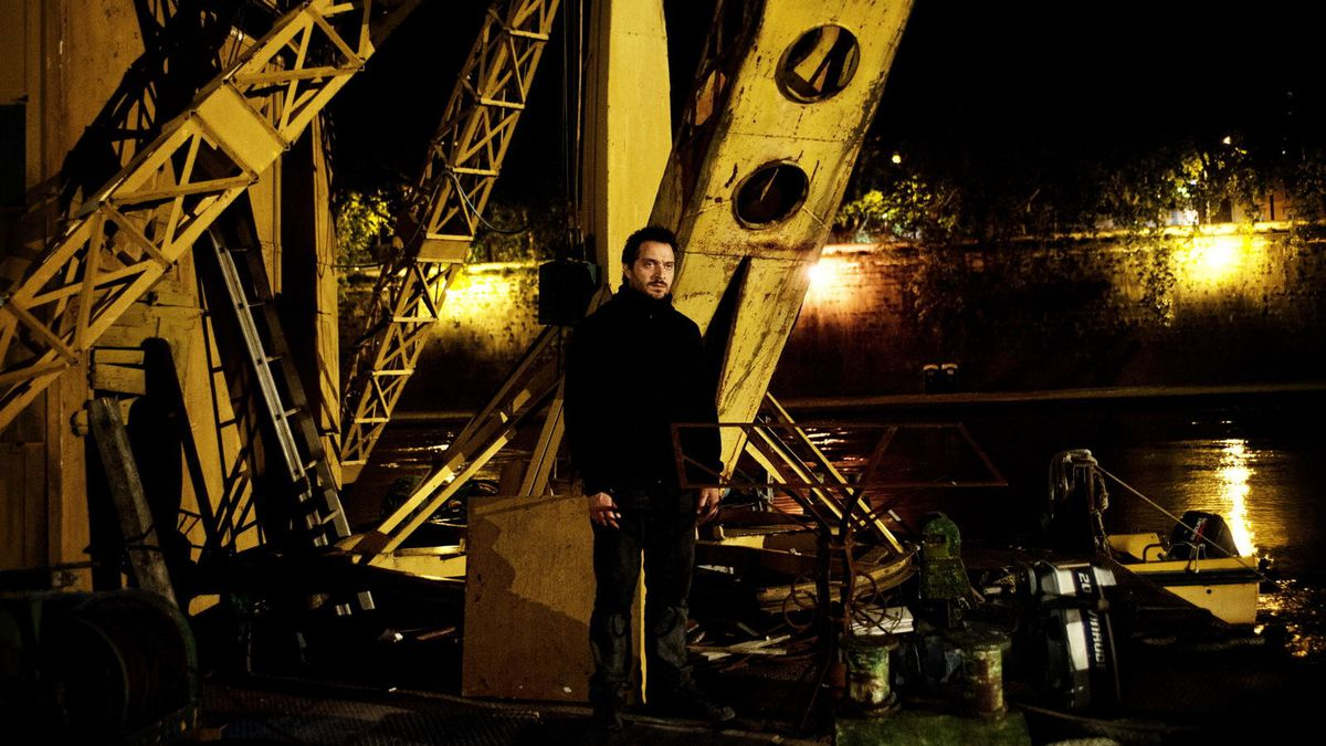 They Call Me Jeeg - Enzo standing on a shipping dock at night
