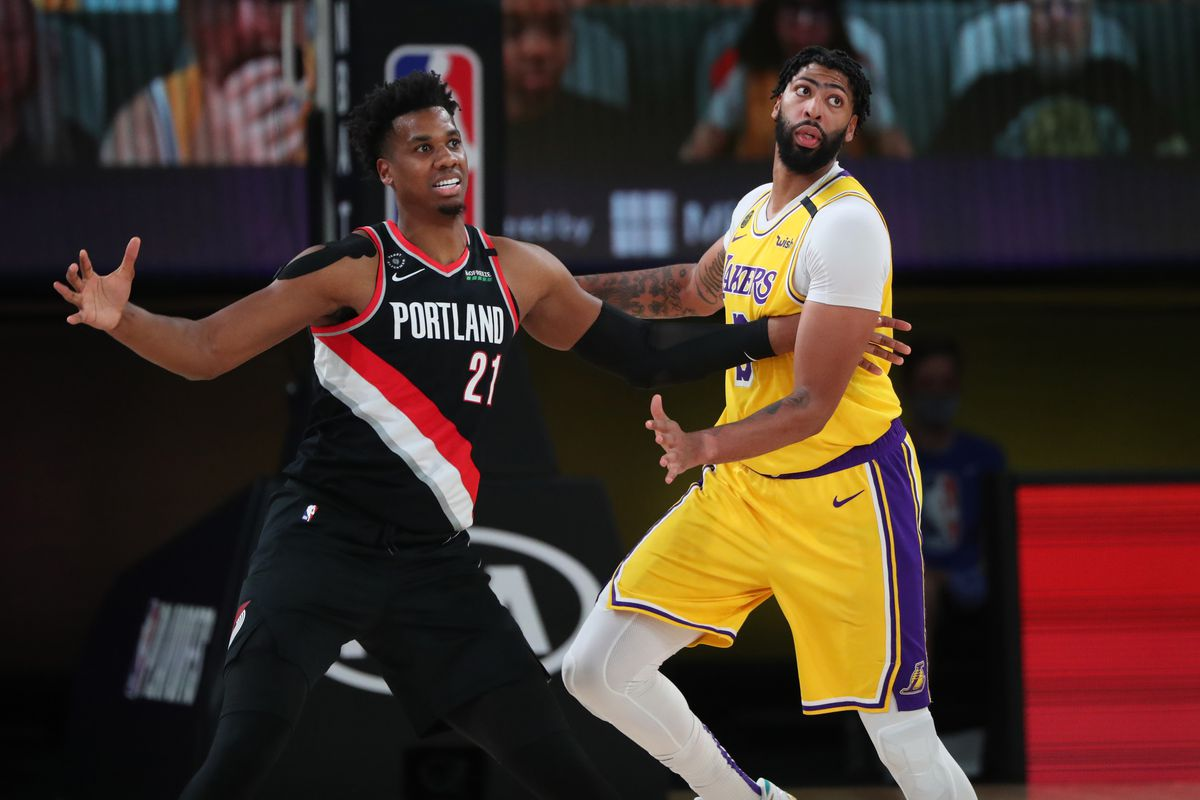 Hassan Whiteside of the Portland Trail Blazers plays defense against the Los Angeles Lakers during Round One, Game One of the NBA Playoffs on August 18, 2020 in Orlando, Florida at The Field House.