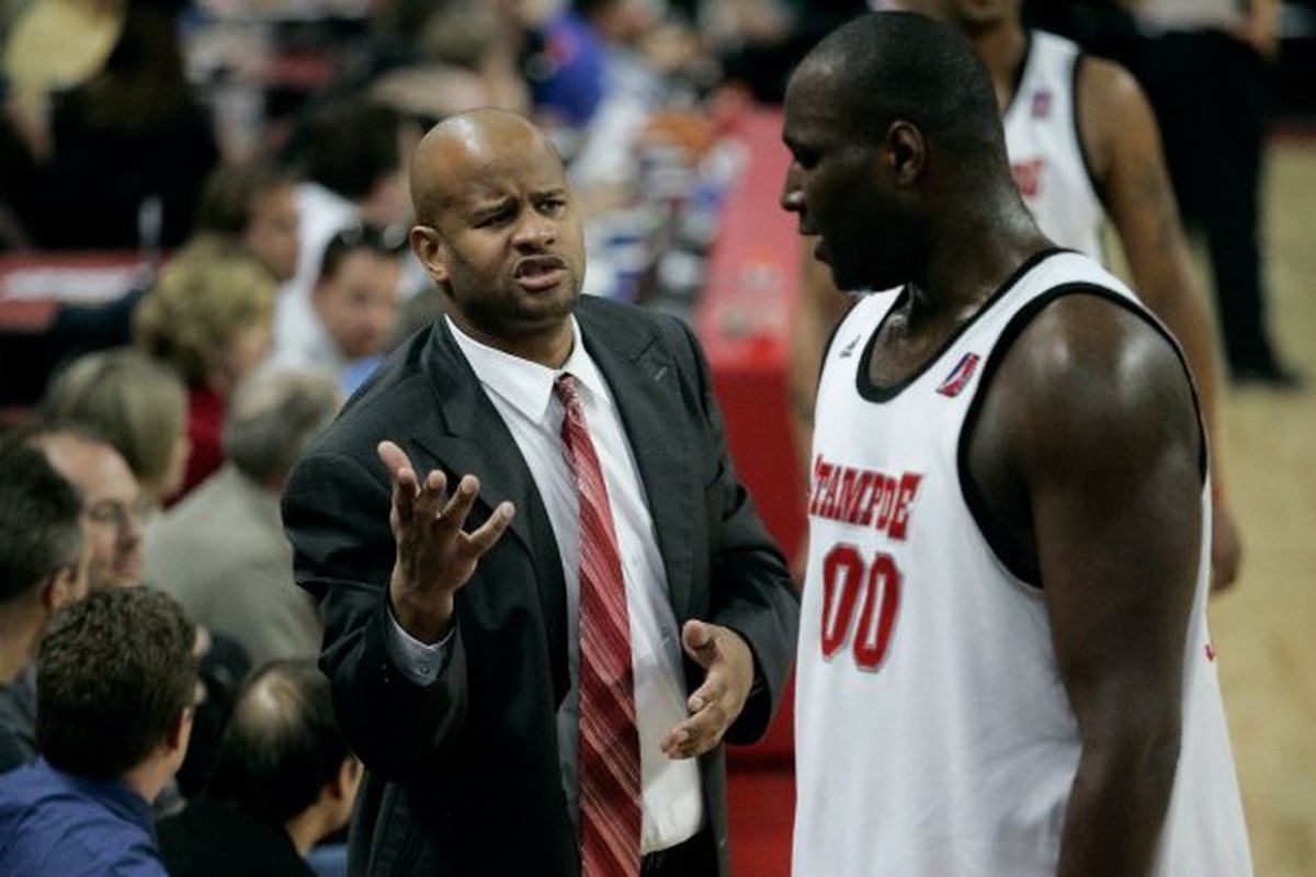 Coach Livingston teaching Nate Jawai something profound during his season as an assistant with the Stampede.