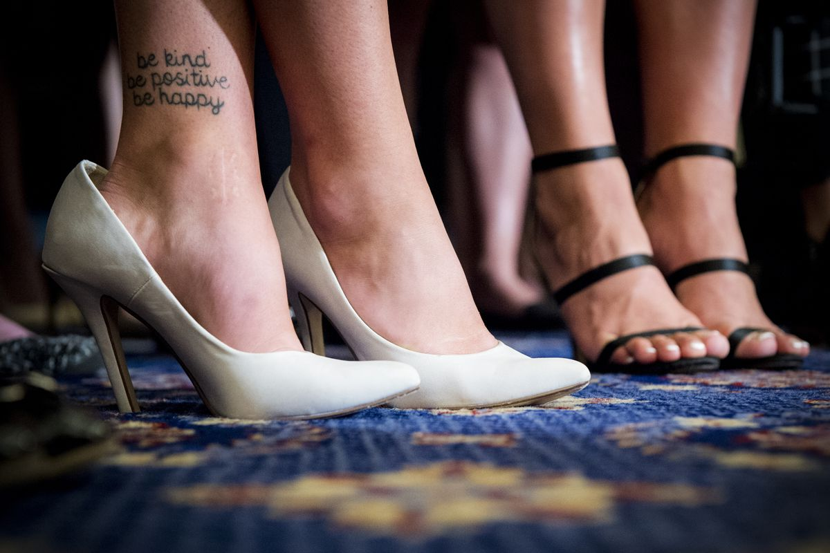 """July 24: A tattoo reading, """"be kind be positive be happy"""" is seen on the ankle of a survivor of sexual abuse by USA gymnastics team doctor Larry Nassar during a press conference on Capitol Hill. Read More.  (Sarah Silbiger/CQ Roll Call)"""