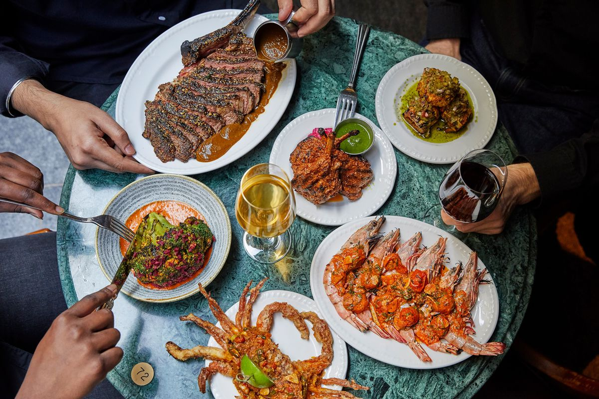 A spread of dishes from Indian restaurant chain Gunpowder, including whole crab, king prawns, and venison doughnuts
