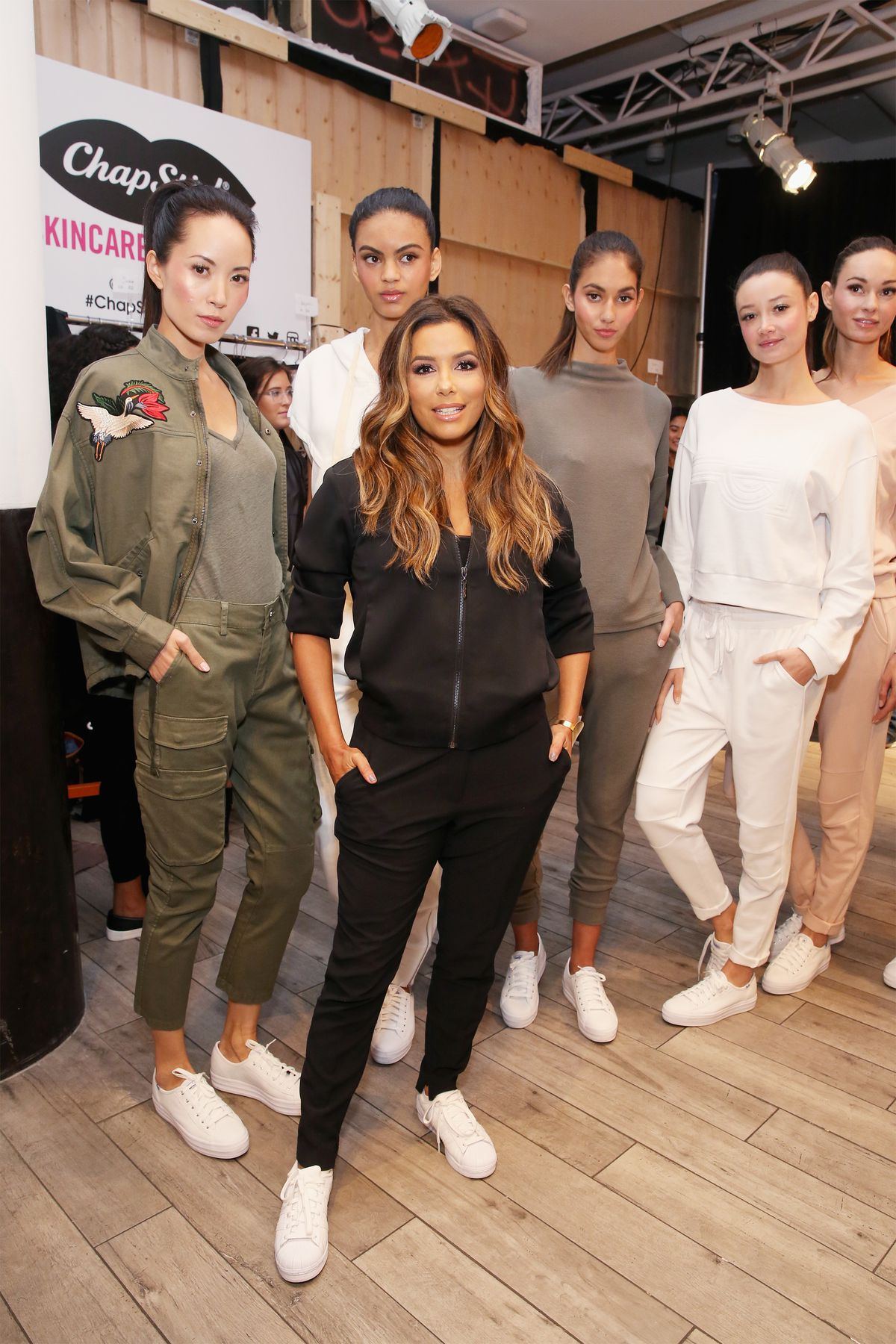 Actress/designer, Eva Longoria, poses backstage with models at the Eva Longoria Collection fashion show during New York Fashion Week: Style360 at Metropolitan Pavilion on September 13, 2017 in New York City.