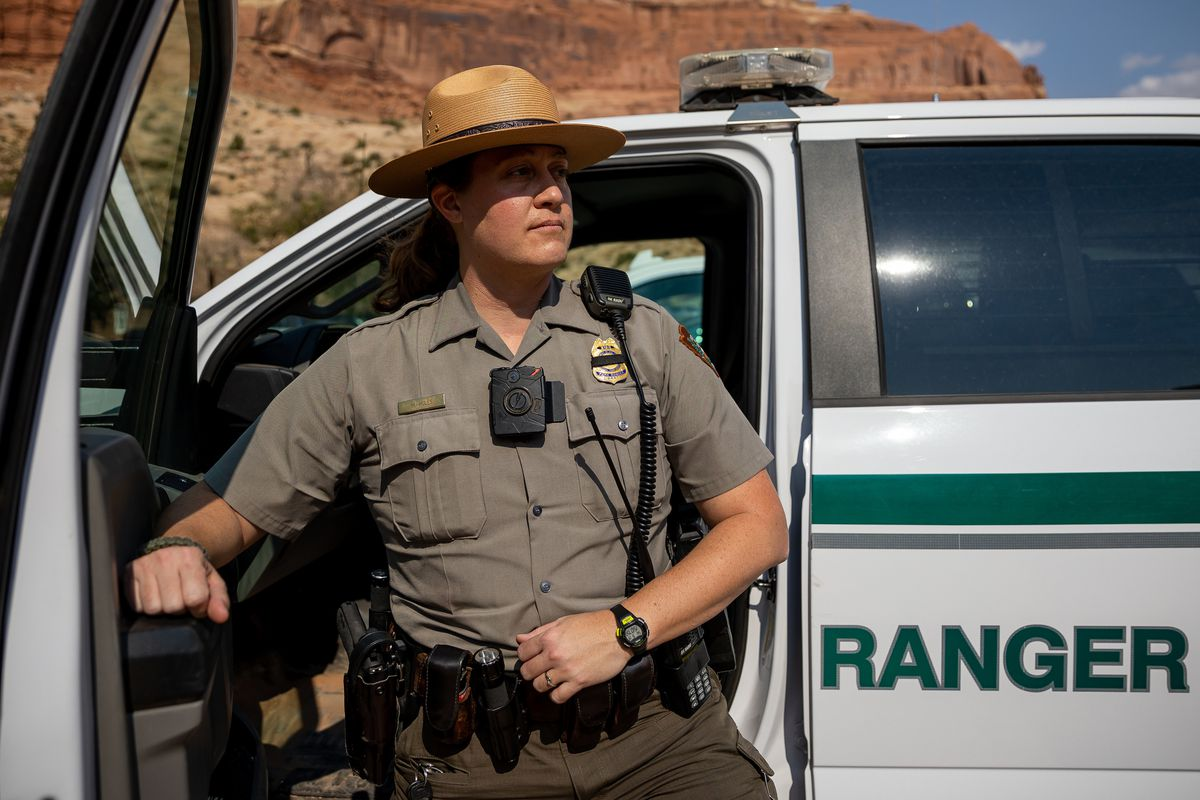 National Park Service ranger Melissa Hulls poses for a photo outside of the visitors center at Arches National Park.