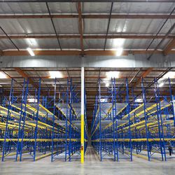Shelving that stretches up to 26 feet in the air waits for boxes full of merchandise.