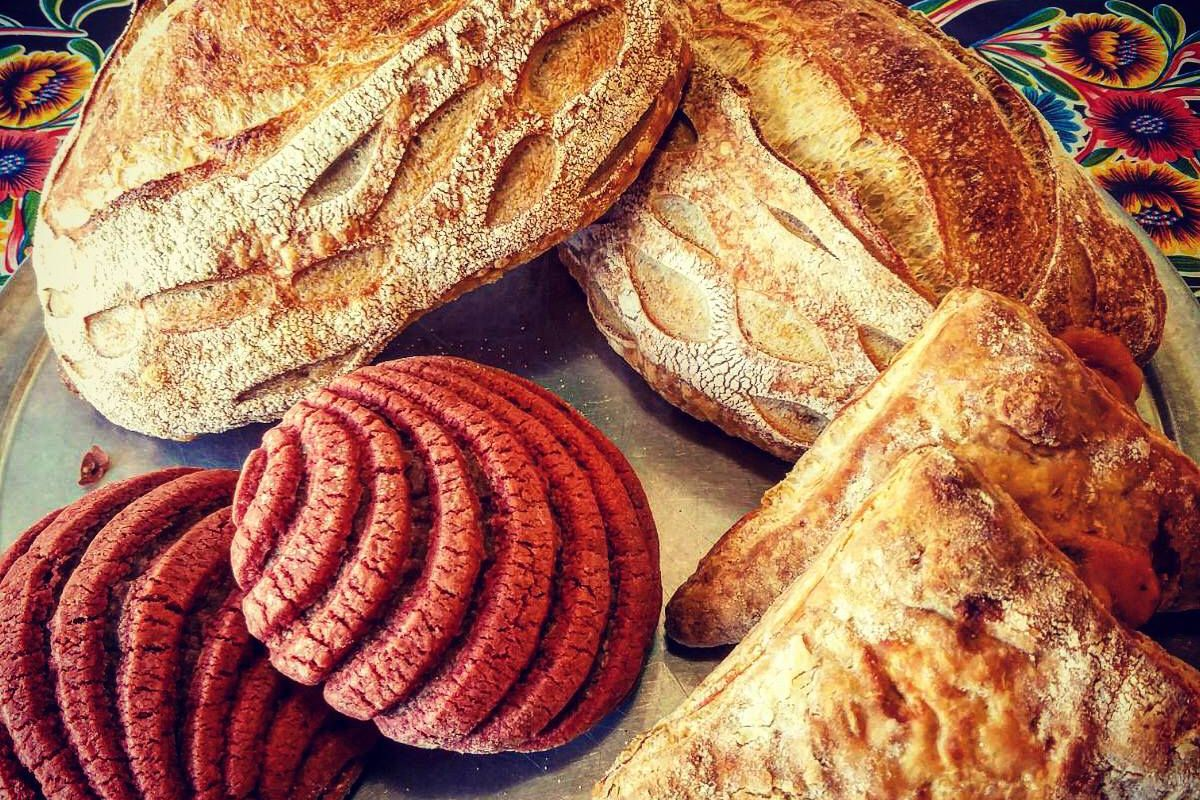 A selection of breads on a tray