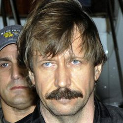 FILE - This Tuesday Nov. 16, 2010 file photo provided by the Drug Enforcement Administration shows Russian arms trafficker Viktor Bout in U.S. custody after being flown from Bangkok to New York in a chartered U.S. plane. The ex-Soviet officer turned arms dealer faces a mandatory minimum of 25 years in prison at sentencing Thursday, April 5, 2012.
