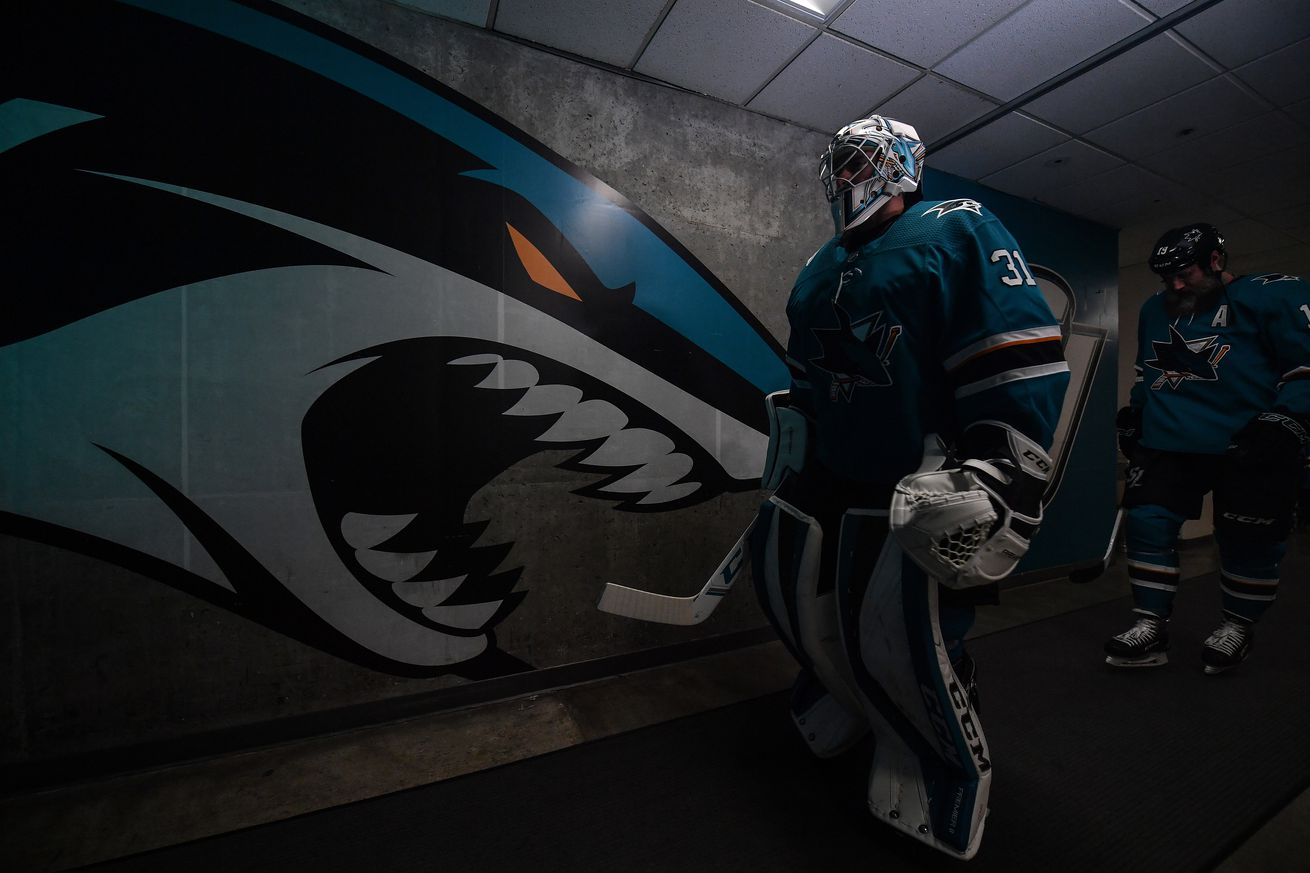 Martin Jones #31 and Joe Thornton #19 of the San Jose Sharks walk out onto the ice to face the Colorado Avalanche at SAP Center on March 8, 2020 in San Jose, California.