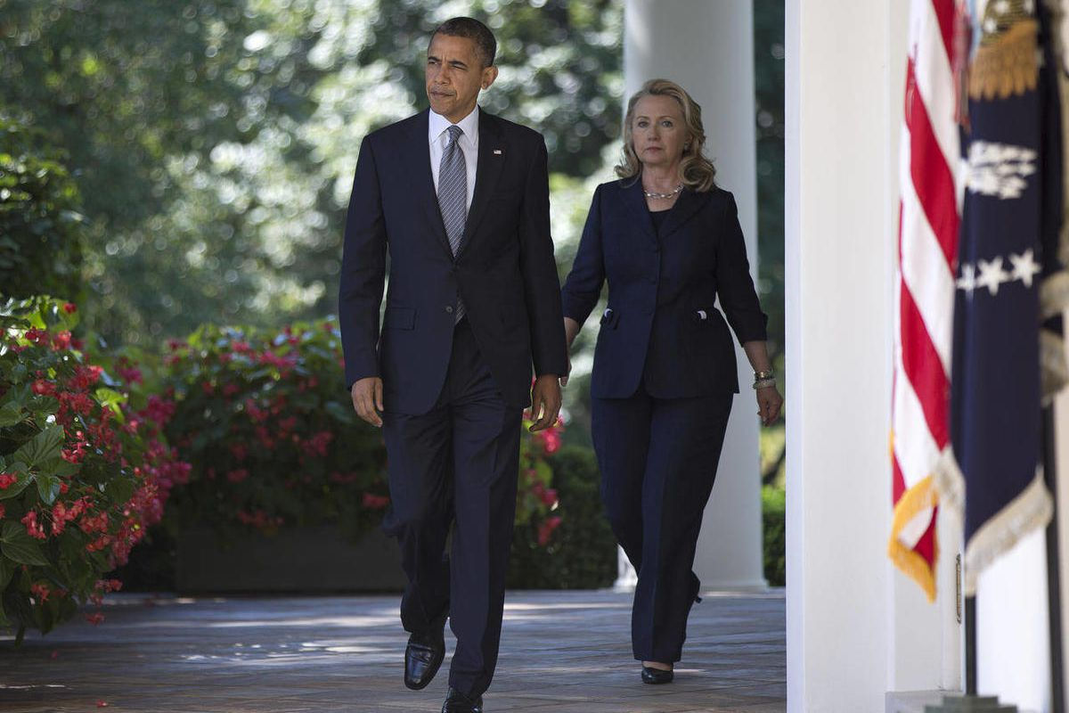 Secretary of State Hillary Clinton walks with President Barack Obama to the Rose Garden of the White House in Washington, Wednesday, Sept. 12, 2012, where he spoke about the death of U.S. ambassador to Libya Christopher Stevens.