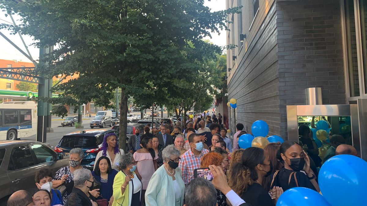 Congregants wait to enter the new home of the Bronx' Evangelical Church Disciples of Christ, June 26, 2021.