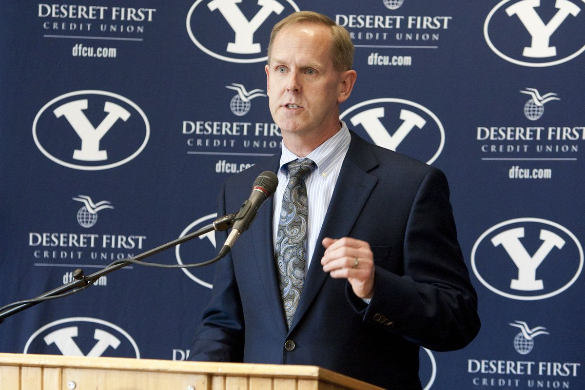 Tom Holmoe, athletic director at Brigham Young University, speaks during a press conference announcing a new contract for coach Dave Rose Wednesday, April 6, 2011.
