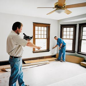 <p>Energy expert Bruce Torrey uses an infrared camera to spot temperature changes inside walls, directing <em>This Old House</em> general contractor Tom Silva as he marks the places where he'll need to beef up insulation.</p>