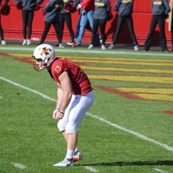 Corey Dunn (13) awaits the snap for his punting opportunity...