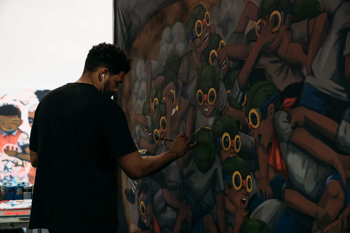Artist Hebru Brantley at work in his studio. Drawing on comic books, Japanese anime and his own street-art roots, Brantley uses his signature, pop-infused characters, Flyboy and Lil Mama, to address a range of socio-political issues. | MAX SCHREIER