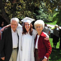 Freshly minted graduate Alex Anderson stands between her grandparents Carl and Rosalin Anderson.